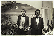 Old Etonians, Danny and Harry Matovu, nephews of the deposed President of Uganda, Godfrey Binaisa. Knebworth. 1981.