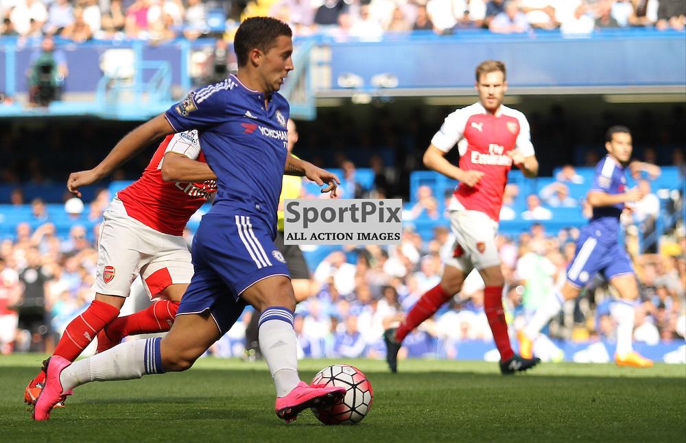 Eden Hazard flies past the Arsenal defence during his teams victory