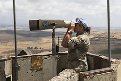 June 21, 2017 - Golan Heights, Israel - CHERYL KIEL, a solider from New Zealand, assigned to the United Nations Truce Supervision Organization, Observer Group Golan, scans the fence between Israel and Syria from a U.N. outpost on Mount Bental in Israel on June 21st, 2017. The fence serves as an agreed upon ceasefire boundary from the Six Day War. (Credit Image: © Alex Edelman via ZUMA Wire)