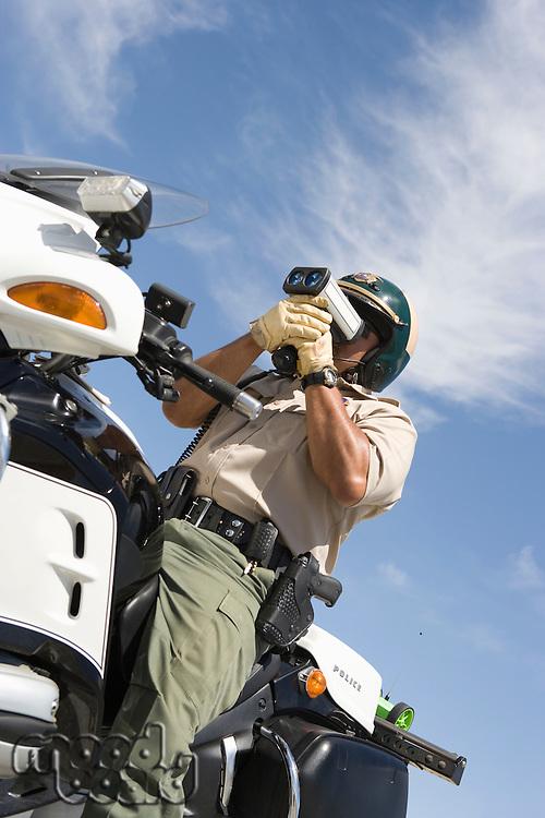 Police officer using speed gun