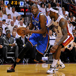 Jun 17, 2012; Miam, FL, USA; Oklahoma City Thunder small forward Kevin Durant (35) drives past Miami Heat small forward LeBron James (6) during the first quarter in game three in the 2012 NBA Finals at the American Airlines Arena. Mandatory Credit: Derick E. Hingle-US PRESSWIRE