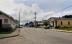 19 May 2015. New Orleans, Louisiana.<br /> The Pigeon Town neighborhood surrounding the derelict Alfred C Priestley Junior High School.<br /> The old school in Pigeon Town has fallen into serious disrepair since 1980 when the last students and teachers left the building. The school was then used as office space and later as a warehouse until 1993. Hurricane Katrina only accelerated the decline. French charter school Lycée Francais recently purchased the crumbling wreck for $425,000 and have grand plans to return a middle and high school to the neighborhood. <br /> Photo; Charlie Varley/varleypix.com