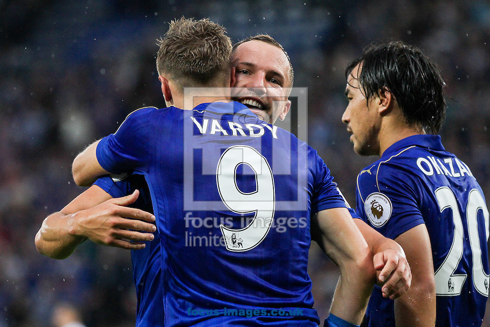Danny Drinkwater of Leicester City (centre) celebrates with goalscorer Jamie Vardy of Leicester City (left) during the Premier League match at the King Power Stadium, Leicester<br /> Picture by Andy Kearns/Focus Images Ltd 0781 864 4264<br /> 27/08/2016