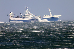 © Licensed to London News Pictures. 01/02/2016. Carnlough, Northern Ireland, UK.The Irish Fishing Vessel Brendelen battles though the North Channel of the Irish Sea as Storm Henry arrives across Northern Ireland. Winds of 70-80mph are expected widely, with 90mph gusts possible in exposed areas. Photo credit : Paul McErlane/LNP