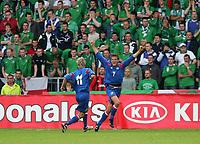 Photo: Andrew Unwin.<br />Northern Ireland v Iceland. European Championships 2008 Qualifying. 02/09/2006.<br />Iceland's Hermann Hreidarsson (R) celebrates his goal.
