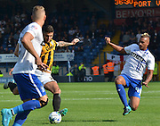 Reece Brown comes in to stop Ryan Inniss shot during the Sky Bet League 1 match between Bury and Port Vale at Gigg Lane, Bury, England on 19 September 2015. Photo by Mark Pollitt.