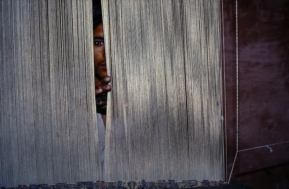 INDIA: Uttar Pradesh<br /> Carpet weaver in Agra
