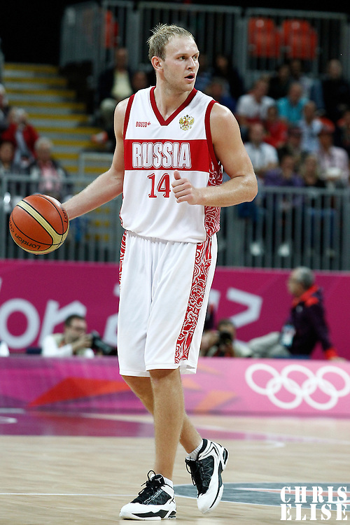 04 August 2012: Russia Anton Ponkrashov brings the ball upcourt during 77-74 Team Russia victory over Team Spain, during the men's basketball preliminary, at the Basketball Arena, in London, Great Britain.