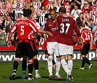 Photo: Paul Greenwood.<br />Sheffield United v West Ham United. The Barclays Premiership. 14/04/2007.<br />West Ham's Bobby Zamora (C) shakes hands with Chris Morgan