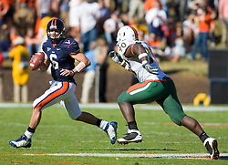 Virginia quarterback Marc Verica (6) avoids Miami (FL) defensive lineman Steven Wesley (90).  The Miami Hurricanes defeated the Virginia Cavaliers 24-17 in overtime in a NCAA Division 1 Football game at Scott Stadium on the Grounds of the University of Virginia in Charlottesville, VA on November 1, 2008.