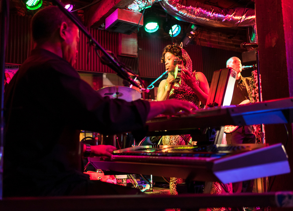 NEW ORLEANS - CIRCA FEBRUARY 2014: Music group performing and dancing in a nightclub during the Mardi Gras celebration in the French Quarter in New Orleans