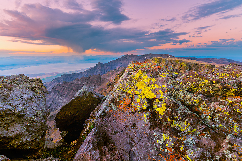 Colorful dawn light warms the lichen-covered rocks on the summit of Steens Mountain, in southeast Oregon.