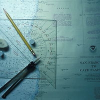 USA, California, Sea charts on oil tanker's bridge as it sails into San Francisco