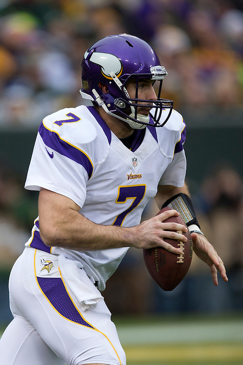 GREEN BAY, WI - DECEMBER 2:  Christian Ponder #7 of the Minnesota Vikings runs the ball against the Green Bay Packers at Lambeau Field on December 2, 2012 in Green Bay, Wisconsin.  The Packers defeated the Vikings 23-14.  (Photo by Wesley Hitt/Getty Images) *** Local Caption *** Christian Ponder