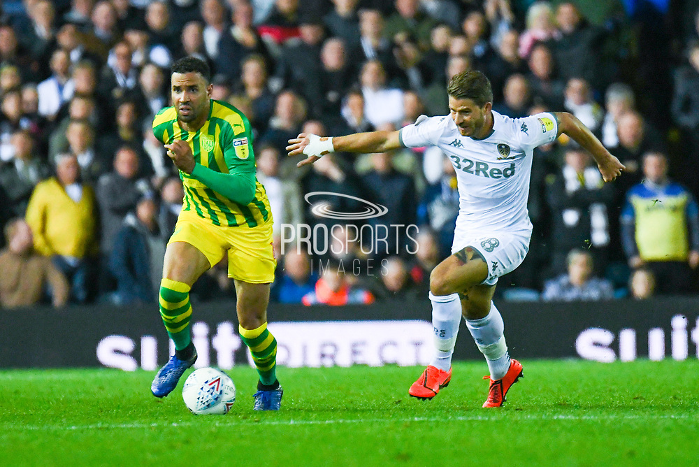 Leeds United defender Gaetano Berardi (28) and West Bromwich Albion forward Hal Robson-Kanu (4) during the EFL Sky Bet Championship match between Leeds United and West Bromwich Albion at Elland Road, Leeds, England on 1 October 2019.