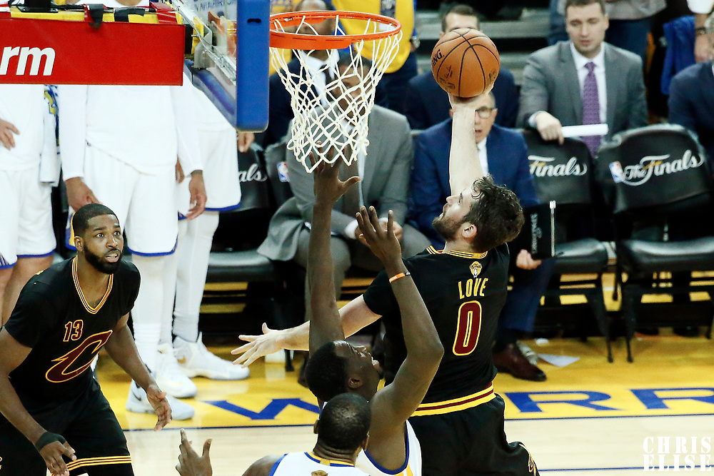 12 June 2017: Cleveland Cavaliers forward Kevin Love (0) goes for the layup against Golden State Warriors forward Draymond Green (23) during the Golden State Warriors 129-120 victory over the Cleveland Cavaliers, in game 5 of the 2017 NBA Finals, at the Oracle Arena, Oakland, California, USA.