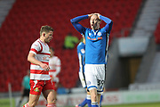 Joe Bunney reacts to a missed chance during the The FA Cup 3rd round match between Doncaster Rovers and Rochdale at the Keepmoat Stadium, Doncaster, England on 6 January 2018. Photo by Daniel Youngs.