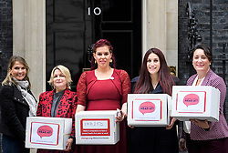 © Licensed to London News Pictures. 08/10/2018. Labour MP LUCIANA BERGER (2R) is joined by campaigner NATASHA DEVON (Centre) and other campaigners as they hand the Mental Health First Aid England petition, titled 'Where's Your Head At?', at the front door of 10 Downing Street, calling for a law change. Photo credit: Ben Cawthra/LNP