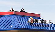 Omaha, Nebraska --<br /> <br /> Law enforcement keeps watch atop Burger King during a demonstration at the intersection of 120th Street and West Center Road on Friday, July 8, 2016, in Omaha. People gathered to protest recent police shootings of black men in Baton Rouge, Louisiana, and the Twin Cities<br /> <br /> <br /> MATT DIXON/THE WORLD-HERALD