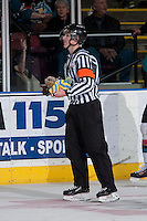 KELOWNA, CANADA -FEBRUARY 25: A referee takes several hats to the officials box after Tyrell Goulbourne #12 of the Kelowna Rockets scored his third goal and fans celebrated the hat trick against the Prince George Cougars on February 25, 2014 at Prospera Place in Kelowna, British Columbia, Canada.   (Photo by Marissa Baecker/Getty Images)  *** Local Caption *** Referee; Tyrell Goulbourne;