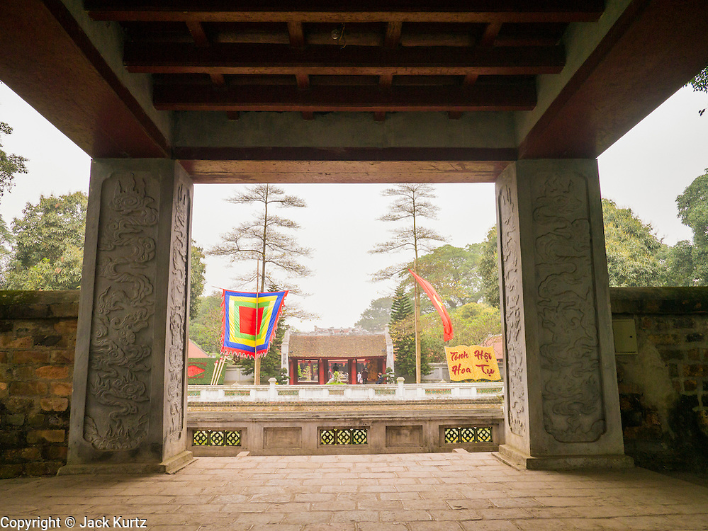 05 APRIL 2012 - HANOI, VIETNAM:  The Khue Van pavilion with the Well of Heavenly Clarity behind it at the Temple of Literature in Hanoi, the capital of Vietnam. The Temple of Literature (Vietnamese: Vn Miu, Hán t) is a temple of Confucius in Hanoi, northern Vietnam. The compound also houses the Imperial Academy (Quc T Giám). The temple also functioned as Vietnam's first university. The temple was first constructed in 1070 under King Lý Nhân Tông and is dedicated to Confucius, sages and scholars.   PHOTO BY JACK KURTZ