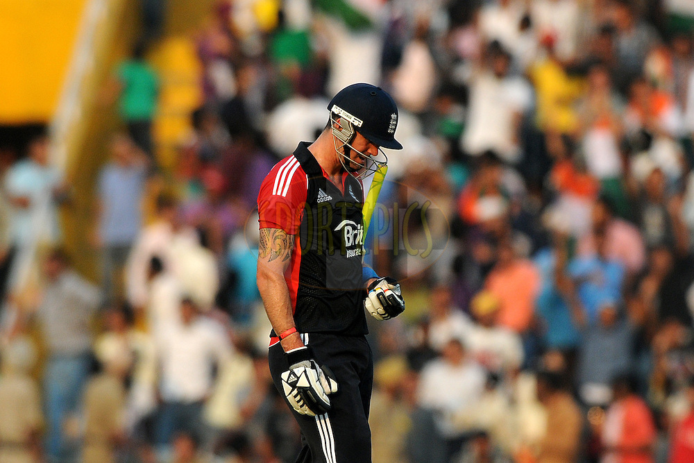 Kevin Pietersen of England walks back after getting out during the 3rd One Day International ( ODI ) match between India and England held at  the PCA Stadium, Mohali on the 20th October 2011..Photo by Pal Pillai/BCCI/SPORTZPICS