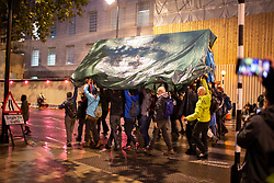 © Licensed to London News Pictures. 07/10/2019. London, UK. Extinction Rebellion protesters remove a structure from Lambeth Bridge. Photo credit: George Cracknell Wright/LNP