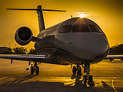Bombardier 605 on the ramp at sunrise. Created as advertising for Phillips 66 Aviation Fuels.  Created by aviation photographer John Slemp of Aerographs Aviation Photography. Clients include Goodyear Aviation Tires, Phillips 66 Aviation Fuels, Smithsonian Air & Space magazine, and The Lindbergh Foundation.  Specialising in high end commercial aviation photography and the supply of aviation stock photography for commercial and marketing use.