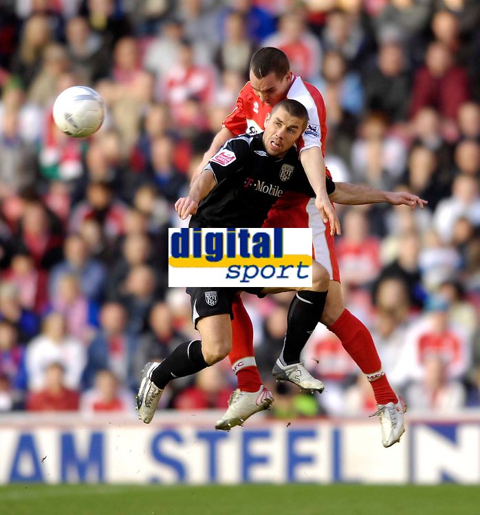 Photo: Jed Wee/Sportsbeat Images.<br /> Middlesbrough v West Bromwich Albion. The FA Cup. 17/02/2007.<br /> <br /> West Brom's former Sunderland striker Kevin Phillips (black) competes with Middlesbrough's Emanuel Pogatetz.