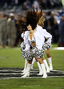 The Oakland Raiders cheerleaders do a hair flip during a dance routine during the NFL week 12 regular season football game against the Kansas City Chiefs on Thursday, Nov. 20, 2014 in Oakland, Calif. The Raiders won their first game of the season 24-20. ©Paul Anthony Spinelli