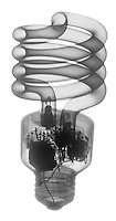 X-ray image of a compact fluorescent bulb (black on white) by Jim Wehtje, specialist in x-ray art and design images.