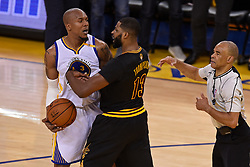 The Golden State Warriors' David West, left, and the Cleveland Cavaliers' Tristan Thompson (13) get physical while reaching for a ball during the second quarter of Game 5 of the NBA Finals at Oracle Arena in Oakland, Calif., on Monday, June 12, 2017. Both players would receive a technical foul. (Photo by Jose Carlos Fajardo/Bay Area News Group/TNS) *** Please Use Credit from Credit Field ***