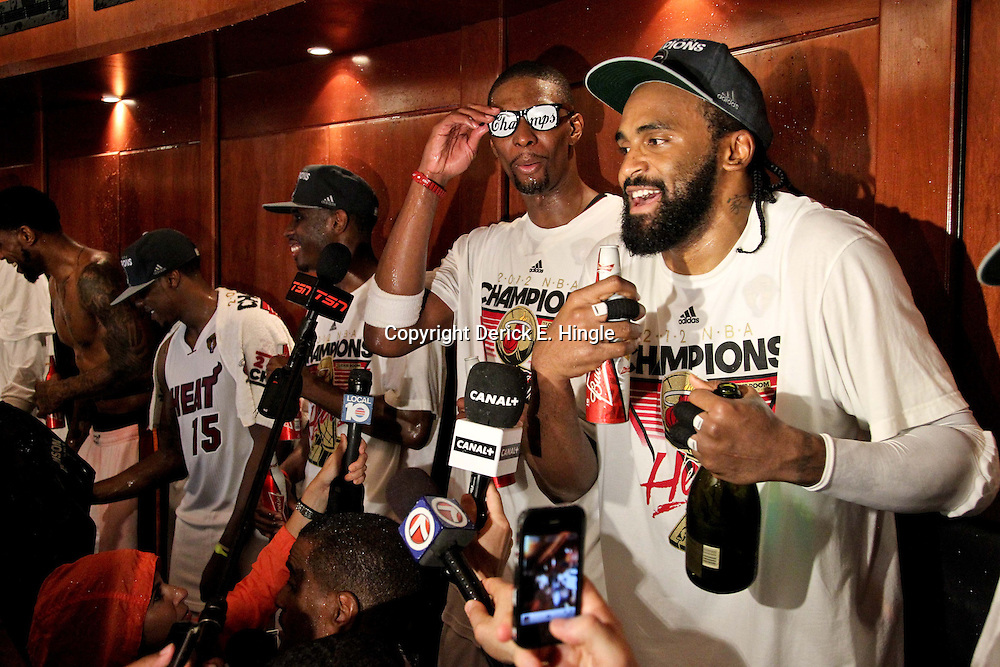 Jun 21, 2012; Miami, FL, USA; Miami Heat power forward Chris Bosh (left) and center Ronny Turiaf (right) celebrate in the locker room after winning the 2012 NBA championship against the Oklahoma City Thunder at the American Airlines Arena. Miami won 121-106. Mandatory Credit: Derick E. Hingle-USA TODAY SPORTS