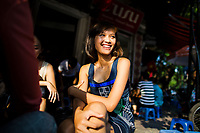 A young woman in a Chula dress in the Old Quarter of Hanoi, Vietnam.