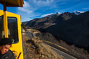 The Train Jaune, Yellow Train, Canari, or Ligne de Cerdagne, crosses the Route National 116 road. The train negotiates a 63km long railway from Villefranche-de-Conflent to Latour-de-Carol, rising from 427m to 1,593m at Bolquère-Eyne, the highest railway station in France. In early 2015 the future of the line was uncertain, with SNCF and the French government considering either to close the line, or to privatise it for tourism use.