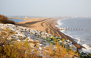 Shingle bay bar and lagoon formed by longshore drift, view north from Bawdsey to Shingle Street, Suffolk, England