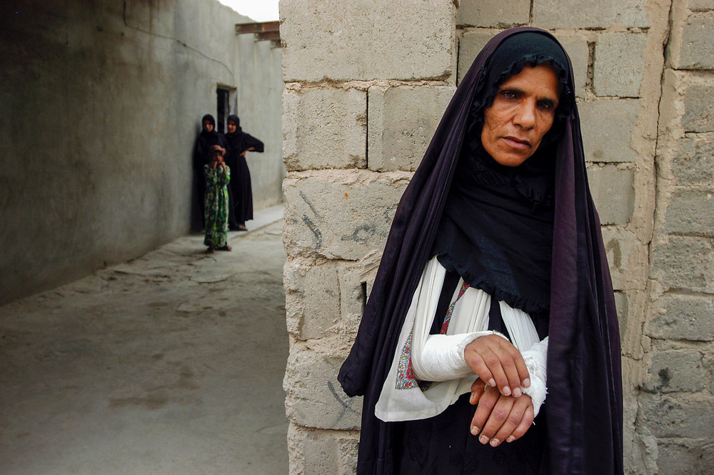 A woman who was seriously wounded when U.S. led forces mistakenly bombed her village in southern Iraq during the invastion of the country. Seventeen houses were destroyed, 32 people were killed and over 30 injured in the attack.<br /> Khamsa Mille, Iraq. 22/05/2003.