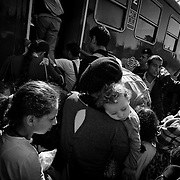 At the Köszke's train station, Hungary, refugees get into a train, chartered by the hungarian authorities, to go to the austrian border, on september 14, 2015. According to the new hungarian laws, refugees cannot cross the border anymore, excepting in specific control points, otherwise, they will be considered as illegal and will be detained or accompanied back to the border they crossed.