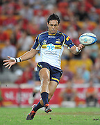 """Christian Lealiifano puts in a chip and chase kick for the Brumbies during the Super 15 Rugby Union match (Round 7) between the Queensland Reds and the ACT Brumbies played at Suncorp Stadium (Brisbane, Australia) on Good Friday 6th April 2012 ~ Queensland (20) defeated the Brumbies (13) ~ This image is intended for Editorial use only - Required Images Credit """"Steven Hight - Aura Images"""""""