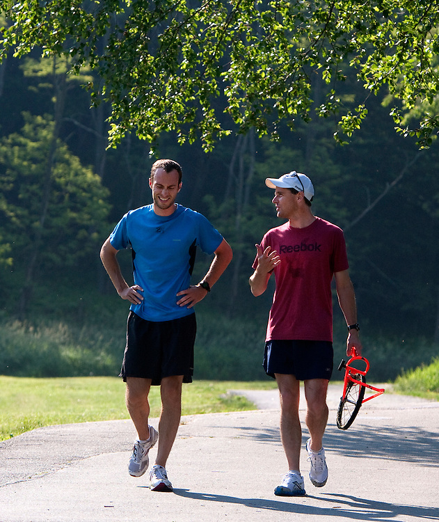Zap Fitness elite athlete coordinators Ryan Warrenburg and Pet Rea chat during a training session for Zap athletes in Boone, NC..