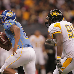 2008 November, 29: Southern University quarterback Warren Matthews (11) runs away from Grambling State defensive tackle Otis Young (94) during a 29-14 win by Grambling State over Southern University during the 35th annual State Farm Bayou Classic at the Louisiana Superdome in New Orleans, LA.  .