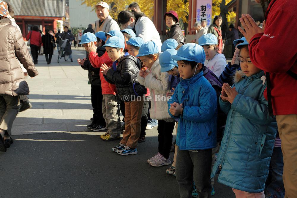 Japanese children at the Asakusa Kannon Temple Tokyo
