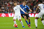 England's Adam Lallana<br /> holds of Estonia midfielder Aleksandr Dmitrijev during the UEFA European 2016 Qualifier match between England and Estonia at Wembley Stadium, London, England on 9 October 2015. Photo by Shane Healey.