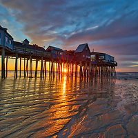 New England sunrise photography of Old Orchard Beach and its historic pier south of Portland, Maine. <br />