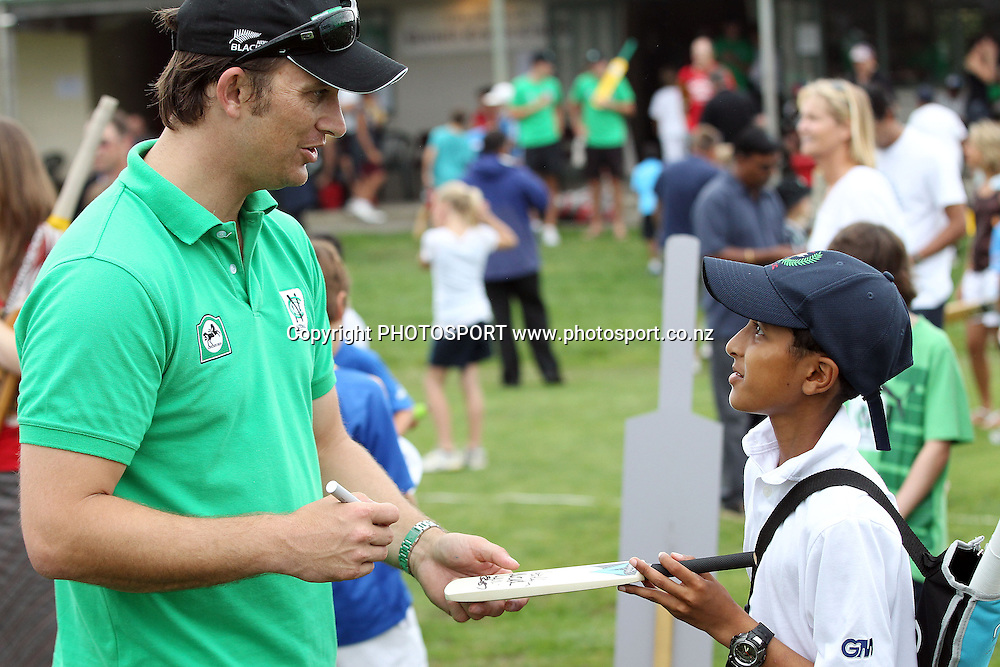 Shane Bond signs and autograph for a young fan at the National Bank's National Cricket Club ( NCC ) Supercamp, Parnell Cricket Club, Auckland, Friday 4 February 2011. Photo: Andrew Cornaga/photosport.co.nz