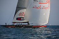 Italy's team Luna Rossa runs downwind under spinnaker toward end of an afternoon of America's Cup fleet racing; Valencia, Spain.