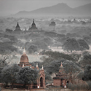 Misty morning in Bagan (ပုဂံ) Myanmar. During the kingdom's height between the 11th and 13th centuries, over 10,000 Buddhist temples, pagodas and monasteries were constructed, of which the remains of over 2,200 temples and pagodas still survive - albeit recent earthquakes have taken their toll on some of the details and towers.