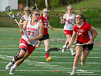 Laconia's Megan Gaspa charges down field with Campbell's Katrina Kopoczynski during NHIAA division III girls lacrosse Wednesday afternoon.  (Karen Bobotas/for the Laconia Daily Sun)