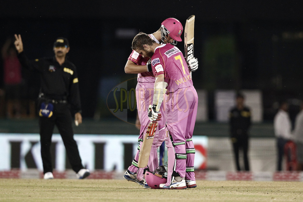 Kane Williamson of the NORTHERN KNIGHTS celebrates his Century  with Mitchell Santner of the NORTHERN KNIGHTS during match 3 of the Oppo Champions League Twenty20 between the Cape Cobras and the Northern Knights held at the Chhattisgarh International Cricket Stadium, Raipur, India on the 19th September 2014<br />