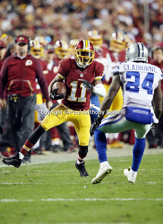 Washington Redskins wide receiver DeSean Jackson (11) looks to dodge a tackle attempt by Dallas Cowboys cornerback Morris Claiborne (24) after catching a second quarter pass during the 2015 week 13 regular season NFL football game against the Dallas Cowboys on Monday, Dec. 7, 2015 in Landover, Md. The Cowboys won the game 19-16. (©Paul Anthony Spinelli)